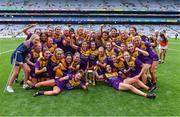 12 September 2021; Wexford players celebrate after their side's victory in the All-Ireland Premier Junior Camogie Championship Final match between Armagh and Wexford at Croke Park in Dublin. Photo by Piaras Ó Mídheach/Sportsfile