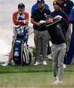 23 September 2021; Shane Lowry of Team Europe, behind, watches on as team-mate Rory McIlroy plays a shot during a practice round prior to the Ryder Cup 2021 Matches at Whistling Straits in Kohler, Wisconsin, USA. Photo by Tom Russo/Sportsfile