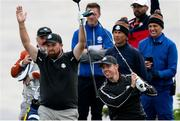 23 September 2021; Shane Lowry of Team Europe, left, reacts after team-mate Rory McIlroy plays a shot during a practice round prior to the Ryder Cup 2021 Matches at Whistling Straits in Kohler, Wisconsin, USA. Photo by Tom Russo/Sportsfile