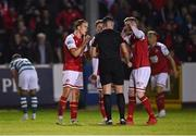 24 September 2021; St Patrick's Athletic players, Matty Smith, left, and Ian Bermingham, right, remonstrate with referee Robert Hennessy during the SSE Airtricity League Premier Division match between St Patrick's Athletic and Shamrock Rovers at Richmond Park in Dublin. Photo by Seb Daly/Sportsfile