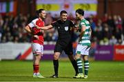 24 September 2021; Referee Robert Hennessy  talks to Ronan Coughlan of St Patrick's Athletic, left, and Richie Towell of Shamrock Rovers during the SSE Airtricity League Premier Division match between St Patrick's Athletic and Shamrock Rovers at Richmond Park in Dublin. Photo by Seb Daly/Sportsfile