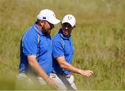 24 September 2021; Shane Lowry, left, and Rory McIlroy of Team Europe during their Friday afternoon fourballs match against Tony Finau and Harris English of Team USA at the Ryder Cup 2021 Matches at Whistling Straits in Kohler, Wisconsin, USA. Photo by Tom Russo/Sportsfile