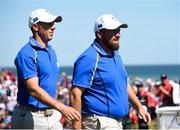 24 September 2021; Rory McIlroy, left, and Shane Lowry of Team Europe during their Friday afternoon fourballs match against Tony Finau and Harris English of Team USA at the Ryder Cup 2021 Matches at Whistling Straits in Kohler, Wisconsin, USA. Photo by Tom Russo/Sportsfile