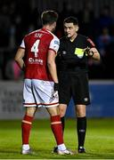 24 September 2021; Referee Robert Hennessy and Sam Bone of St Patrick's Athletic during the SSE Airtricity League Premier Division match between St Patrick's Athletic and Shamrock Rovers at Richmond Park in Dublin. Photo by Seb Daly/Sportsfile