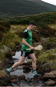 25 September 2021; Cathal Kiely of Offaly crosses the stream during the M. Donnelly GAA All-Ireland Poc Fada finals at Annaverna Mountain in the Cooley Peninsula, Ravensdale, Louth. Photo by Ben McShane/Sportsfile