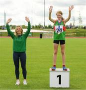 25 September 2021; Kate Brennan from Cong, Mayo, after she won the Girls under-14 Hurdles with Irish sprinter from Mayo Sarah Quinn during the Aldi Community Games Track and Field Athletics finals at Carlow IT Sports Campus in Carlow. Photo by Matt Browne/Sportsfile