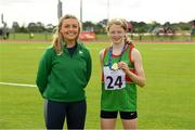25 September 2021; Kate Brennan from Cong, Mayo, after she won the Girls under-14 Hurdles with Irish sprinter Sarah Quinn during the Aldi Community Games Track and Field Athletics finals at Carlow IT Sports Campus in Carlow. Photo by Matt Browne/Sportsfile