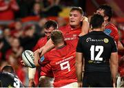 25 September 2021; Gavin Coombes of Munster, centre, is congratulated by team-mates after scoring their side's fourth try during the United Rugby Championship match between Munster and Cell C Sharks at Thomond Park in Limerick. Photo by Seb Daly/Sportsfile