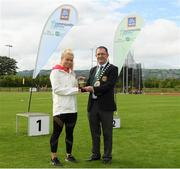 25 September 2021; Gerry McGuinness, President of the Community Games, makes a presentation to Irish sprinter Molly Scott during the Aldi Community Games Track and Field Athletics finals at Carlow IT Sports Campus in Carlow. Photo by Matt Browne/Sportsfile