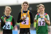 25 September 2021; Nicole Griffin, 5, from Ballynally-Lissycasey, Clare, with her gold medal she won in the Girls under-10 200 metre with third place Holly Mcelarney, left, from Mayo and second place Nicole Rigney, right, from Carlow during the Aldi Community Games Track and Field Athletics finals at Carlow IT Sports Campus in Carlow. Photo by Matt Browne/Sportsfile