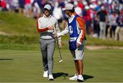 25 September 2021; Rory McIlroy of Team Europe hands his putter to caddie Harry Diamond during his Saturday afternoon fourballs match against Dustin Johnson and Collin Morikawa of Team USA at the Ryder Cup 2021 Matches at Whistling Straits in Kohler, Wisconsin, USA. Photo by Tom Russo/Sportsfile