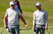 25 September 2021; Ian Poulter, left, and Rory McIlroy of Team Europe during their Saturday afternoon fourballs match against Dustin Johnson and Collin Morikawa of Team USA at the Ryder Cup 2021 Matches at Whistling Straits in Kohler, Wisconsin, USA. Photo by Tom Russo/Sportsfile