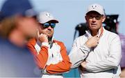 25 September 2021; Team Europe captain Padraig Harrington, right, and vice captain Graeme McDowell during the Saturday afternoon fourball matches at the Ryder Cup 2021 Matches at Whistling Straits in Kohler, Wisconsin, USA. Photo by Tom Russo/Sportsfile