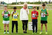 25 September 2021; Ireland sprinters Molly Scott, with, from left, under-12 ball throw medalists, fourth place Ryan McCormack from Mayo, third place Amer Almulhem from Roscommon, first place Sam Kingston from Skibereen, Cork, and second place Kevin O'Shea from Kerry during the Aldi Community Games Track and Field Athletics finals at Carlow IT Sports Campus in Carlow. Photo by Matt Browne/Sportsfile