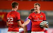 25 September 2021; Mike Haley, right, and Ben Healy of Munster celebrate their side's fifth try, scored by team-mate Chris Cloete, during the United Rugby Championship match between Munster and Cell C Sharks at Thomond Park in Limerick. Photo by Seb Daly/Sportsfile