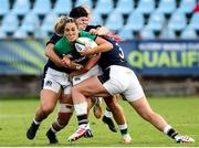 25 September 2021; Sene Naoupu of Ireland is tackled by Christine Belisle of Scotland during the Rugby World Cup 2022 Europe qualifying tournament match between Ireland and Scotland at Stadio Sergio Lanfranchi in Parma, Italy. Photo by Roberto Bregani/Sportsfile