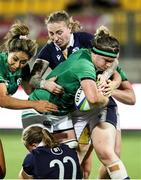 25 September 2021; Ciara Griffin of Ireland is tackled by Sarah Law of Scotland during the Rugby World Cup 2022 Europe qualifying tournament match between Ireland and Scotland at Stadio Sergio Lanfranchi in Parma, Italy. Photo by Roberto Bregani/Sportsfile