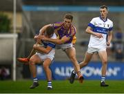 26 September 2021; Marc L'estrange of St Vincent's is tackled by Paul Mannion of Kilmacud Crokes during the Go Ahead Dublin Senior Club Football Championship Group 2 match between Kilmacud Crokes and St Vincents at Parnell Park in Dublin. Photo by David Fitzgerald/Sportsfile