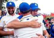 26 September 2021; Ian Poulter of Team Europe is consoled by vice captain Martin Kaymer after winning his Sunday singles match 3&2 against Tony Finau of Team USA at the Ryder Cup 2021 Matches at Whistling Straits in Kohler, Wisconsin, USA. Photo by Tom Russo/Sportsfile