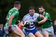 26 September 2021; Matthew Ruane of Breaffy in action against Davin Morrin, right, and Ronan Varley of The Neale during the Mayo Senior Club Football Championship Group 4 match between Breaffy and The Neale at Breaffy GAA Club in Mayo. Photo by Piaras Ó Mídheach/Sportsfile