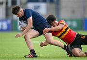 29 September 2021; Ferdia Spain of Wesley College is tackled by Liam Guckian of CBC Monkstown during the Bank of Ireland Leinster Schools Junior Cup Round 1 match between CBC Monkstown and Wesley College at Energia Park in Dublin. Photo by Harry Murphy/Sportsfile