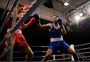 2 October 2021; Kelyn Cassidy of Saviours Crystal Boxing Club, Waterford, right, and Tommy Hyde of St Michael's Boxing Club, Athy, Kildare, during their 80kg bout at the IABA National Elite Boxing Championships Finals in the National Stadium in Dublin. Photo by Seb Daly/Sportsfile