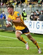 2 October 2021; Ethan McIlroy of Ulster on his way to scoring a try during the United Rugby Championship match between Zebre and Ulster at Stadio Sergio Lanfranchi in Parma, Italy. Photo by Roberto Bregani/Sportsfile