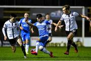 1 October 2021; Dan Hawkins of Finn Harps in action against Darragh Leahy, left, and Greg Sloggett of Dundalk during the SSE Airtricity League Premier Division match between Finn Harps and Dundalk at Finn Park in Ballybofey, Donegal. Photo by Ramsey Cardy/Sportsfile