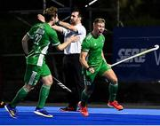 5 October 2021; Conor Empey of Ireland celebrates after scoring his side's third goal with team-mate Michael Robson, left, during an international friendly match between Ireland and Malaysia at Lisnagarvey Hockey Club in Hillsborough, Down. Photo by Ramsey Cardy/Sportsfile