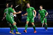 5 October 2021; Conor Empey of Ireland celebrates after scoring his side's third goal with team-mate Daragh Walsh, left, during an international friendly match between Ireland and Malaysia at Lisnagarvey Hockey Club in Hillsborough, Down. Photo by Ramsey Cardy/Sportsfile