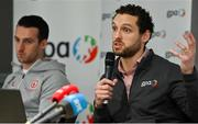 7 October 2021; GPA CEO Tom Parsons, in the company of GPA national executive committee member and Tyrone footballer Niall Morgan, speaking at a GPA Media Conference at the Crowne Plaza Hotel in Santry, Dublin, to address the upcoming GAA inter-county football championship structure proposals. Photo by Brendan Moran/Sportsfile
