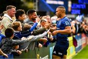 9 October 2021; Adam Byrne of Leinster celebrates with supporters after his side's victory in the United Rugby Championship match between Leinster and Zebre at the RDS Arena in Dublin. Photo by Harry Murphy/Sportsfile