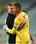 9 October 2021; Republic of Ireland manager Stephen Kenny celebrates with Republic of Ireland goalkeeper Gavin Bazunu after their side's victory in the FIFA World Cup 2022 qualifying group A match between Azerbaijan and Republic of Ireland at the Olympic Stadium in Baku, Azerbaijan. Photo by Stephen McCarthy/Sportsfile