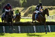 10 October 2021; Off Your Rocco, right, with Jack Kennedy up, jumps the last on their way to winning the Bluegrass Horse Feed Novice Hurdle, from second place The Little Yank, left, with Danny Mullins up, at Limerick Racecourse in Patrickswell, Limerick. Photo by Seb Daly/Sportsfile