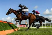 10 October 2021; Off Your Rocco, left, with Jack Kennedy up, jumps the last on their way to winning the Bluegrass Horse Feed Novice Hurdle, from second place The Little Yank, behind, with Danny Mullins up, at Limerick Racecourse in Patrickswell, Limerick. Photo by Seb Daly/Sportsfile