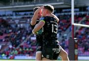 10 October 2021; Liam Coombes, right, of Munster celebrates with team-mate Neil Cronin after scoring his side's second try during the United Rugby Championship match between Scarlets and Munster at Parc Y Scarlets in Llanelli, Wales. Photo by Gareth Everett/Sportsfile