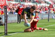 10 October 2021; Calvin Nash of Munster dives in to score try during the United Rugby Championship match between Scarlets and Munster at Parc Y Scarlets in Llanelli, Wales. Photo by Gareth Everett/Sportsfile