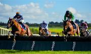 10 October 2021; Kruzhlinin, left, with Jordan Gainfords up, jumps the last on their way to winning the David Fitzgerald Memorial Handicap Hurdle, from second place Buck Rogers, right, with Brian Hayes up, at Limerick Racecourse in Patrickswell, Limerick. Photo by Seb Daly/Sportsfile