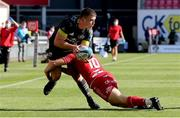10 October 2021; Calvin Nash of Munster is tackled by Sam Costelow of Scarlets during the United Rugby Championship match between Scarlets and Munster at Parc Y Scarlets in Llanelli, Wales. Photo by Gareth Everett/Sportsfile