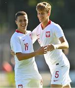 10 October 2021; Maksymilian Dziuba of Poland, left, celebrates with team-mate Tomasso Guercio after scoring their side's first goal during the UEFA U17 Championship Qualifying Round Group 5 match between Poland and Andorra at The Mardyke in Cork. Photo by Eóin Noonan/Sportsfile