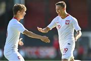 10 October 2021; Maksymilian Dziuba of Poland, right, celebrates with team-mate Tomasso Guercio after scoring their side's first goal during the UEFA U17 Championship Qualifying Round Group 5 match between Poland and Andorra at The Mardyke in Cork. Photo by Eóin Noonan/Sportsfile