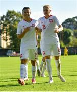 10 October 2021; Maksymilian Dziuba of Poland, left, celebrates after scoring his side's first goal during the UEFA U17 Championship Qualifying Round Group 5 match between Poland and Andorra at The Mardyke in Cork. Photo by Eóin Noonan/Sportsfile