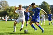 10 October 2021; Tomasso Guercio of Poland in action against Gerard Sanchez Navarro of Andorra during the UEFA U17 Championship Qualifying Round Group 5 match between Poland and Andorra at The Mardyke in Cork. Photo by Eóin Noonan/Sportsfile