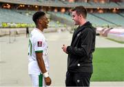 9 October 2021; Republic of Ireland's Chiedozie Ogbene with Kieran Crowley, FAI communications executive, following the FIFA World Cup 2022 qualifying group A match between Azerbaijan and Republic of Ireland at the Olympic Stadium in Baku, Azerbaijan. Photo by Stephen McCarthy/Sportsfile