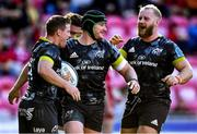 10 October 2021; Chris Cloete of Munster, centre, celebrates scoring his side's sixth try with team-mates during the United Rugby Championship match between Scarlets and Munster at Parc Y Scarlets in Llanelli, Wales. Photo by Ben Evans/Sportsfile