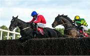 10 October 2021; Ontheropes, left, with Sean O'Keeffe up, jumps the last on their way to winning the JT McNamara Ladbrokes Munster National Handicap Steeplechase, from second place A Wave Of The Sea, with Simon Torrens up, at Limerick Racecourse in Patrickswell, Limerick. Photo by Seb Daly/Sportsfile