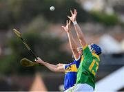 10 October 2021; Chrissy McMahon of Dunloy in action against Gerard Walsh of O'Donovan Rossa during the Antrim County Senior Club Hurling Championship Final match between Dunloy and O'Donovan Rossa at Corrigan Park in Belfast. Photo by Ramsey Cardy/Sportsfile