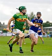 10 October 2021; Kevin Molloy of Dunloy in action against Gerard Walsh of O'Donovan Rossa during the Antrim County Senior Club Hurling Championship Final match between Dunloy and O'Donovan Rossa at Corrigan Park in Belfast. Photo by Ramsey Cardy/Sportsfile