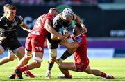 10 October 2021; Fineen Wycherley of Munster is tackled by Johnny Williams and Lloyd Ashley of Scarlets during the United Rugby Championship match between Scarlets and Munster at Parc Y Scarlets in Llanelli, Wales. Photo by Ben Evans/Sportsfile