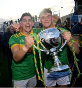 10 October 2021; Sean Elliott, left, and Eoin O'Neill of Dunloy with the trophy following the Antrim County Senior Club Hurling Championship Final match between Dunloy and O'Donovan Rossa at Corrigan Park in Belfast. Photo by Ramsey Cardy/Sportsfile